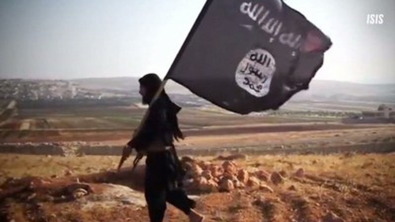 Proof of existential ISIS threat: a guy wearing black Pajama in a Sanddle carrying a Black flag